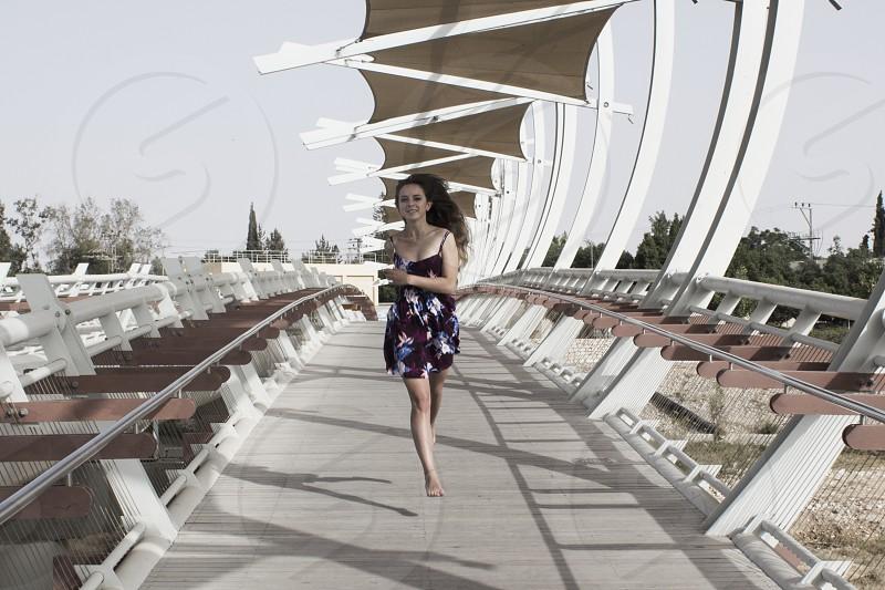 woman in black spaghetti strap romper shorts running photo