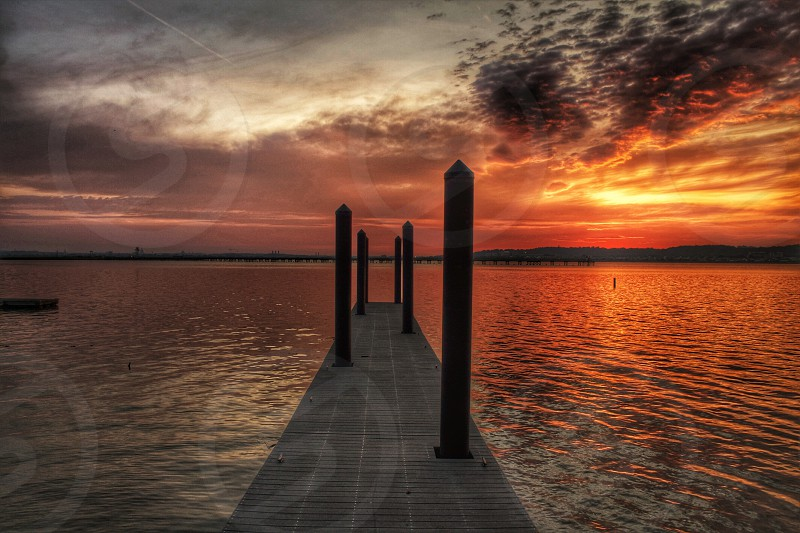 view of sunset on wooden dock photo