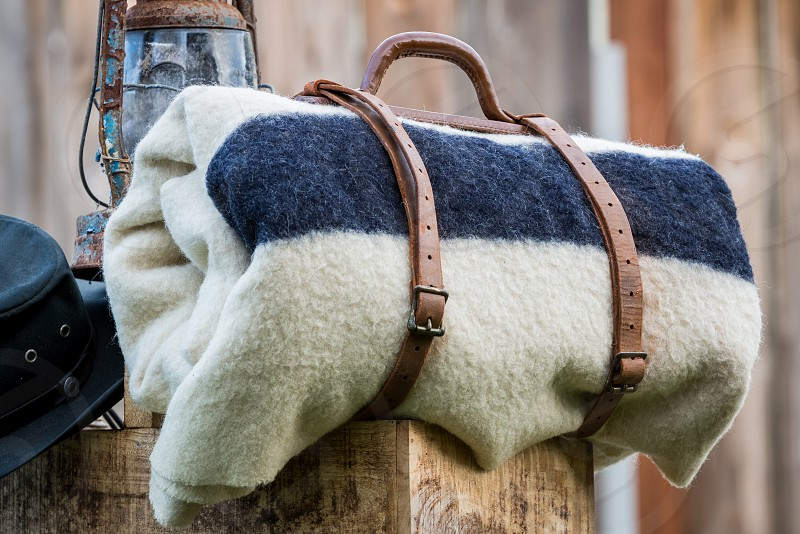 Blanket warm wool leather winter season bedding bed roll western rustic  photo