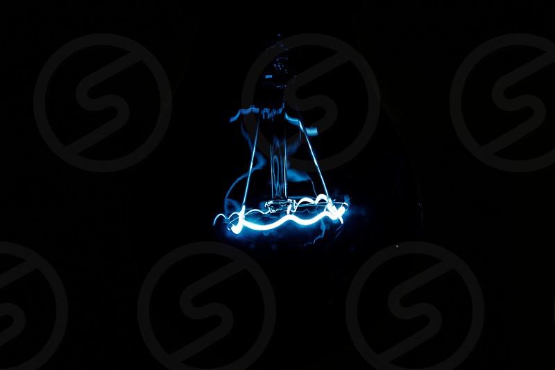 blue tinted light on black background photo