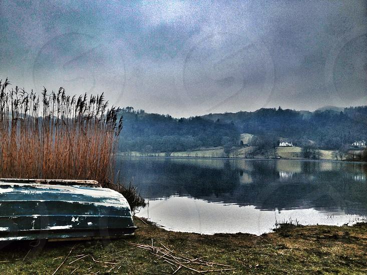 Reflectionreflectionslakewaterrowingboatblue photo
