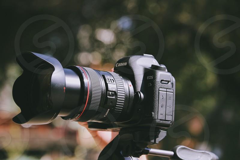 black canon dslr camera in macro lens photography photo