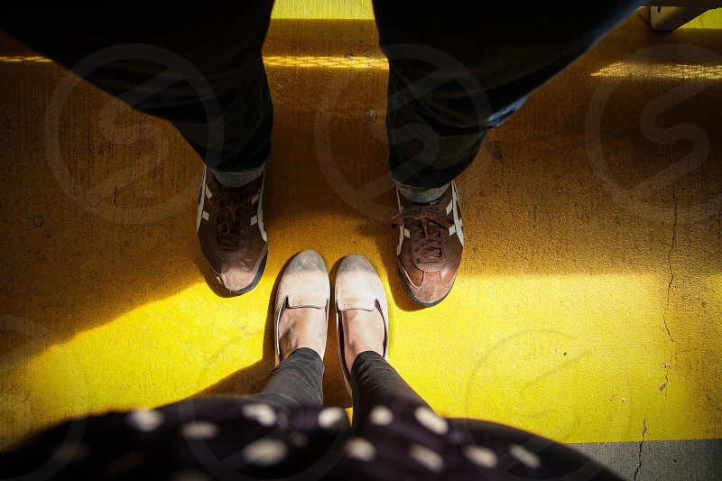 2 person wearing shoes standing photo