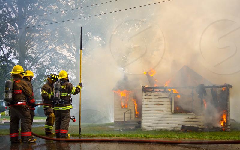 firefighter fire battle danger flames heat hot hero heroric team work hard work danger dangerous rescue photo