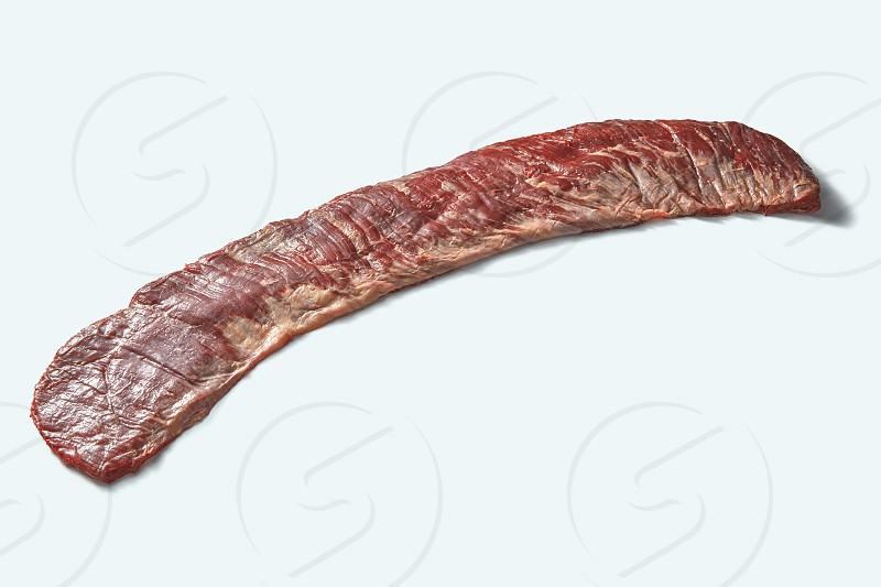 Bavette steak or flank steak on a white background. Fresh raw organic veal meat on a white with place for text. photo