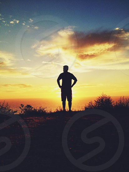 man standing silhouette photo