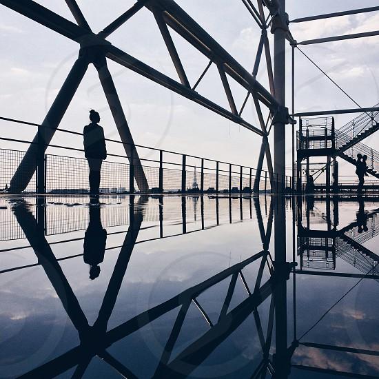 woman standing on bridge photography photo
