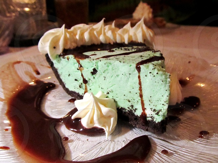 Green grasshopper mint pie with chocolate drizzle photo