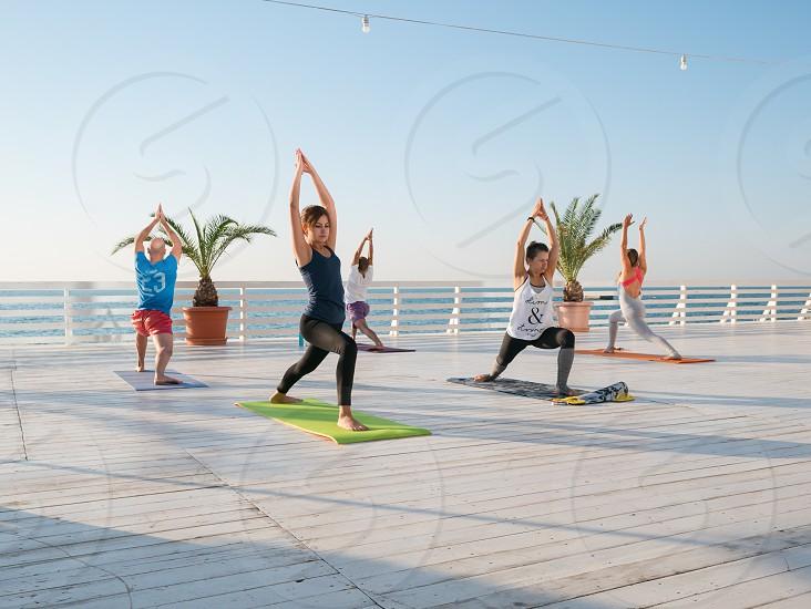 people doing yoga photo