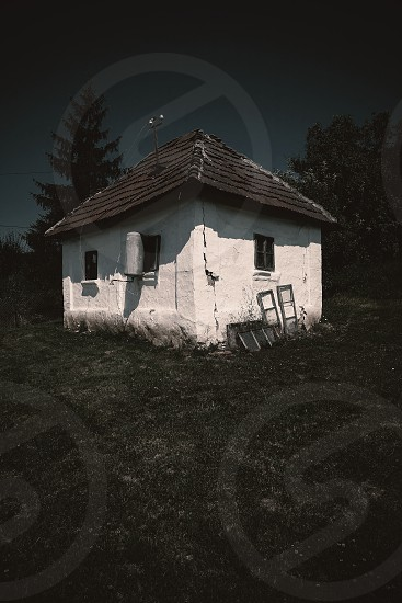 Exterior of an old abandoned village house dramatic scene.  photo