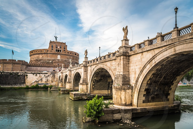 Bridge and Mausoleum Castel Sant Angelo at sunset. The Mausoleum of Hadrian usually known as Castel Sant'Angelo is a towering cylindrical building in Rome photo
