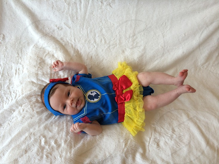 baby wearing blue red yellow outfit photo