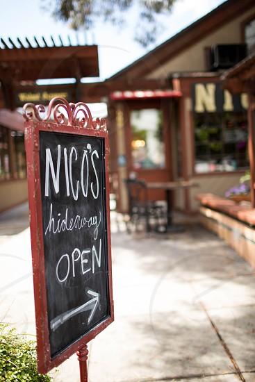 brown nicos hideramy open signage during daytime photo