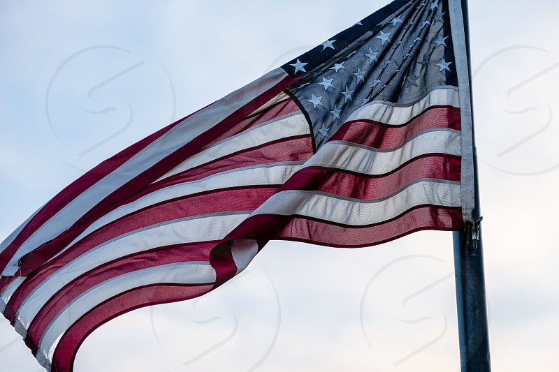 The American flag proudly flies in the wind photo