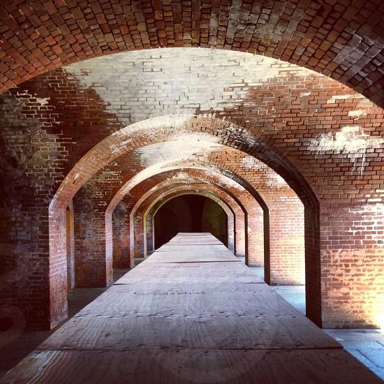 columns of brown bricks archways  photo