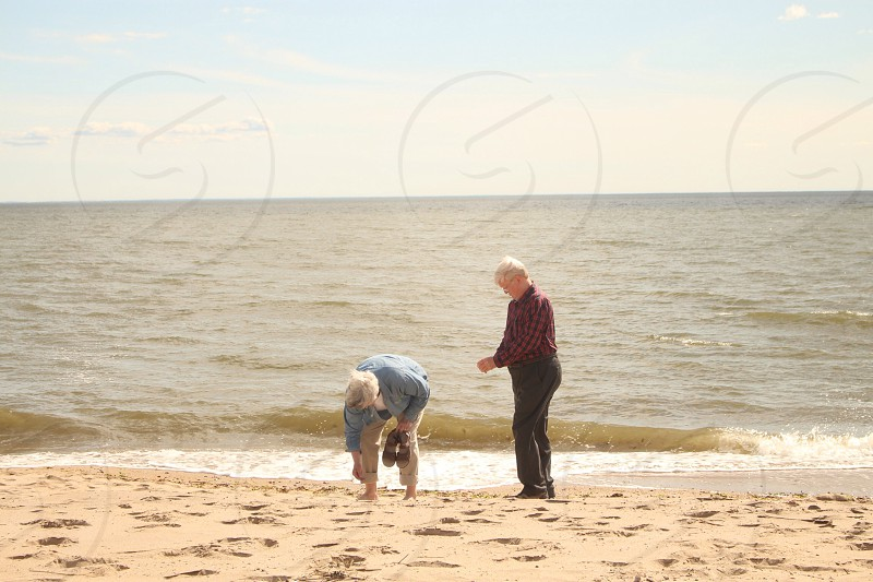 2 persons on shore photo