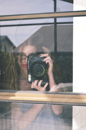 Anna Anderson snapping a pic with a Fujifilm Instax Wide Camera photo