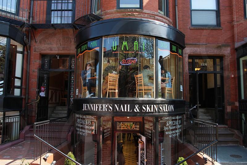 architectural photography of jennifer's nail & skin salon during daytime photo