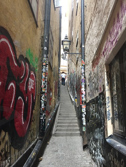 Alley man stairs photo