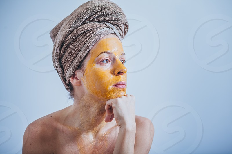Young woman with an egg mask on her face photo