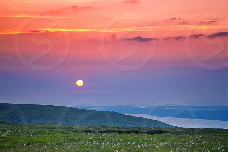 sunset view over green mountain photo
