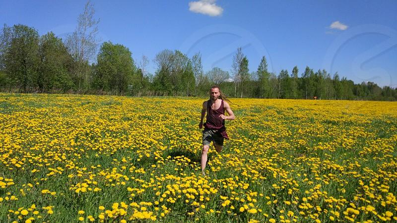 the guy runs across the field photo