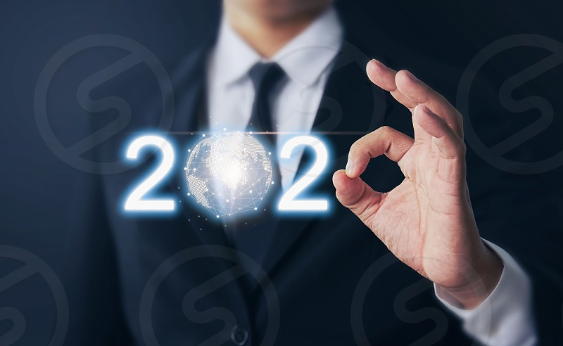 Businessman hands shows ok sign and growth success in 2020 modern circle global network connection Technology iot (Internet of think). Business new year card. photo