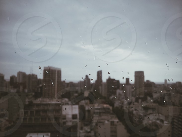 Buenos Aires Argentina city cityscape skyline rain storm blurry focus window raindrops window view dark atmospheric photo
