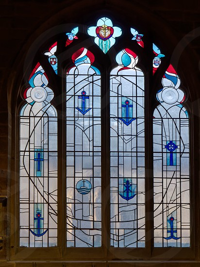 NEWCASTLE UPON TYNE TYNE AND WEAR/UK - JANUARY 20 : Stained Glass Window in the Cathedral in Newcastle upon Tyne Tyne and Wear on January 20 2018 photo