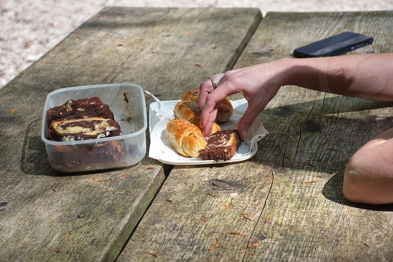 Rolls and sweet food on the wooden table photo