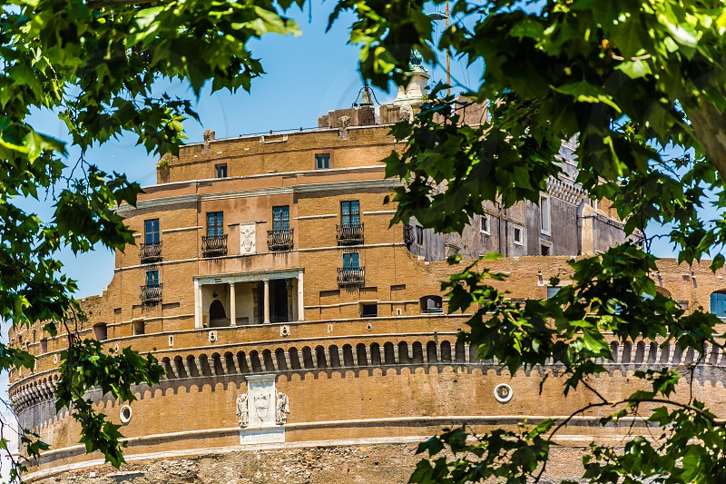 Castel Sant'Angelo through the trees of Lungotevere in Rome photo