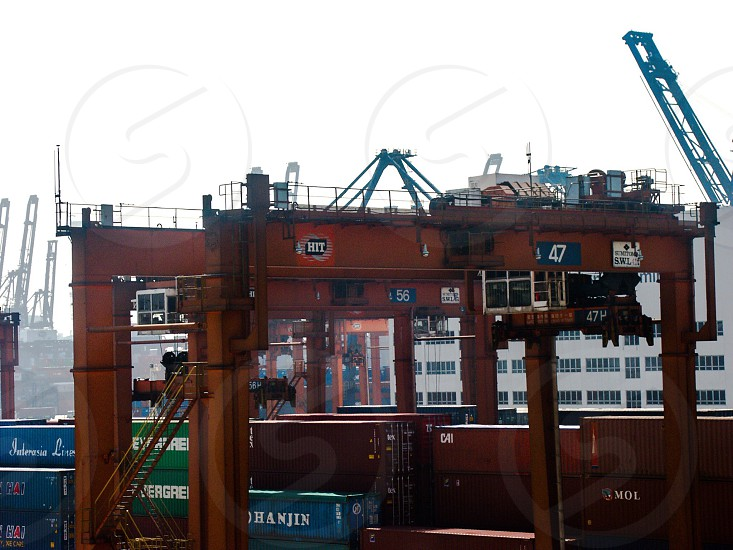photo of red metal platform surrounded with intermodal containers photo