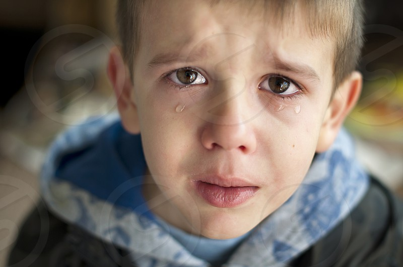Sad child who is crying. Close up photo