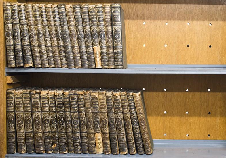 Old books on shelf. French encyclopedia photo