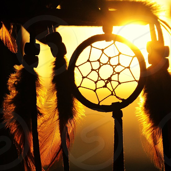 black dream catcher silhouette photography photo