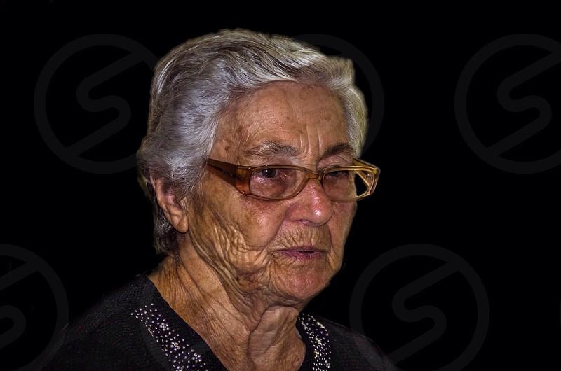woman in brown framed eyeglasses photo
