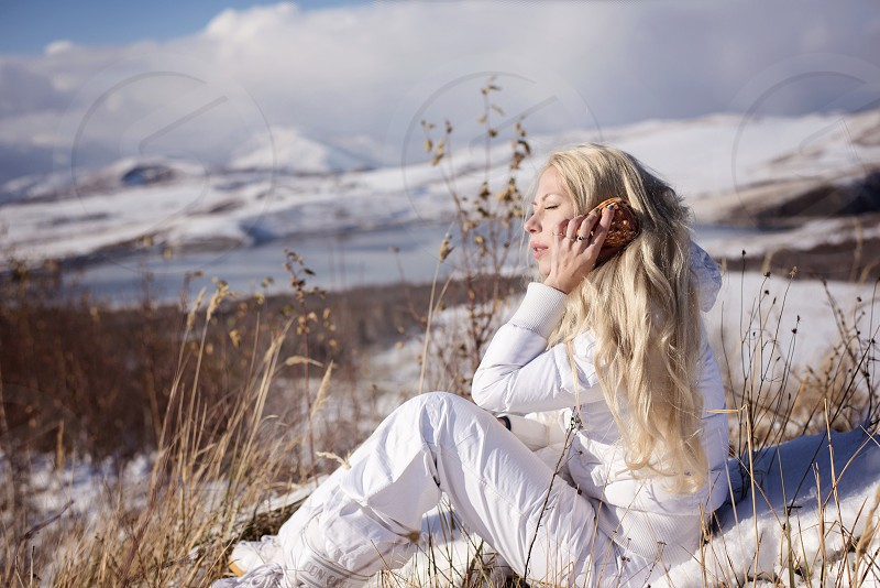 girl shell winter snow could mountain dream enjoy freedom holiday travel photo