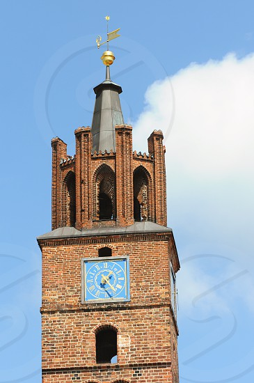 tower of old town hall of Brandenburg an der Havel (Germany) with its typical clock. photo
