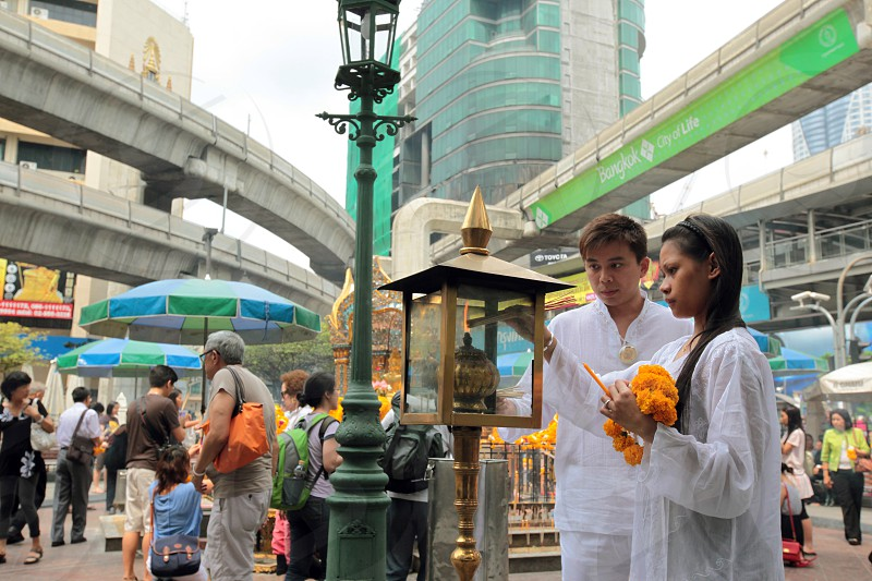 the Erawan Shrine in the city centre at the pratunam aerea in the city of Bangkok in Thailand in Suedostasien. photo