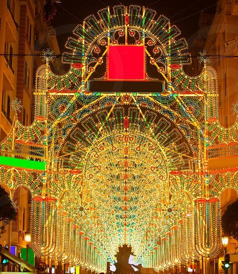 Beautiful night lights in Fallas fest of Valencia in calle Sueca street Spain photo