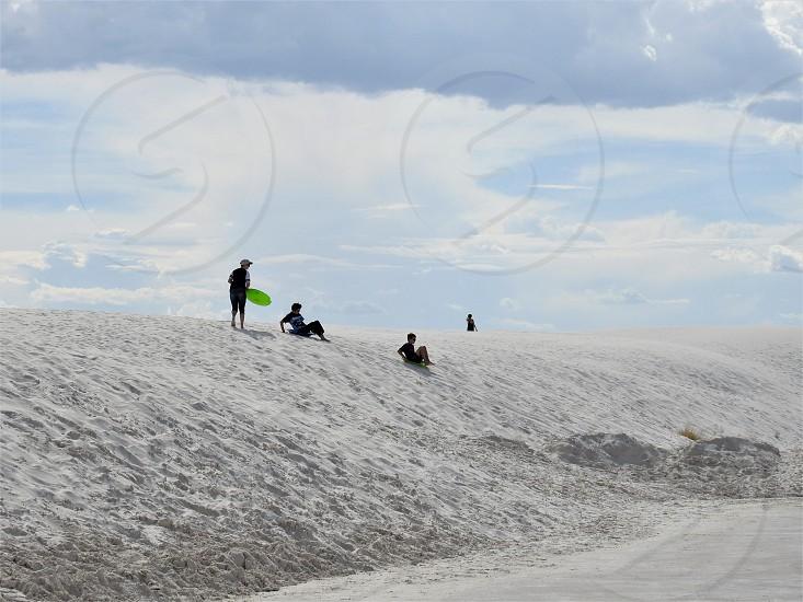 Sliding Down White Sands National Monument photo