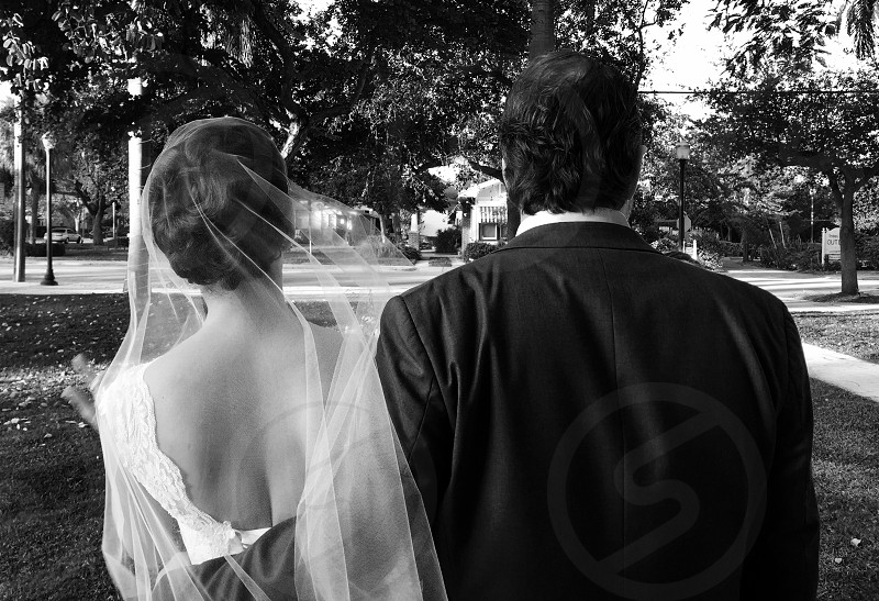 gray scale photo of groom and bride photo