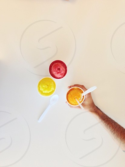 3red and yellow  food on plastic cup  photo