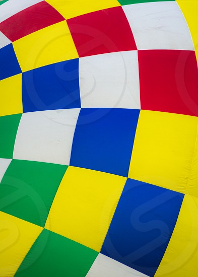 yellow red white and blue checked hot air balloon photo
