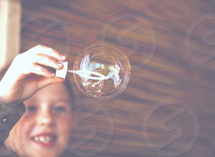 Fragile bubble colors girl kid children happy photo