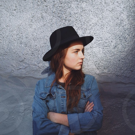 woman with black hat and denim jacket photo