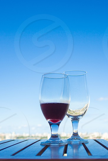 two wine glass on a wooden table photo