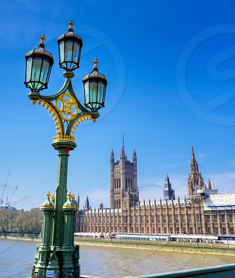British Parliament along the River Thames on a sunny day in London UK. photo