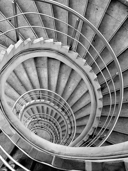 top view of spiral staircase in grayscale photography photo
