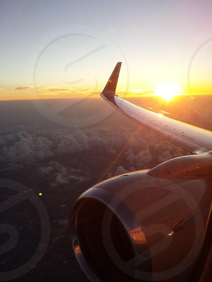 Sunrise travel aircraft airplane engine jet reflection photo